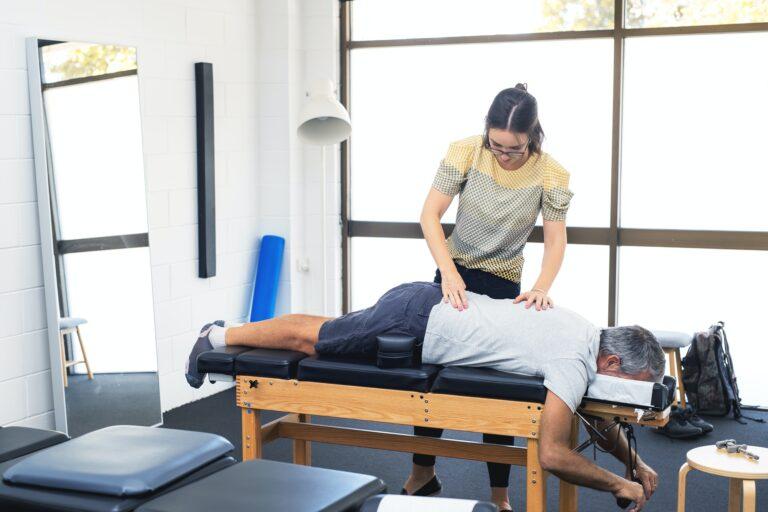 Senior man having chiropractic adjustment.