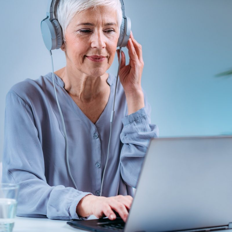 Senior Woman Doing Audiogram Hearing Test at Home, using Laptop
